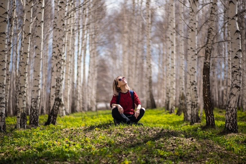 woman sitting in aspen forest