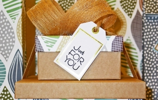 "Closeup of gift with a card that says ""Just For You"""