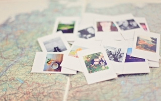 blurred image of a pile of photos on top of a map