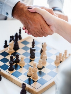 handshake over chessboard