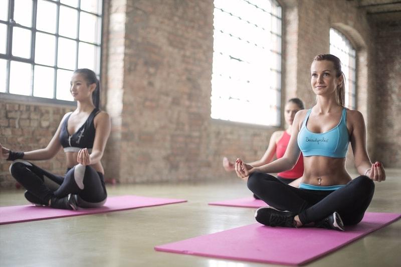 Women in yoga class meditating