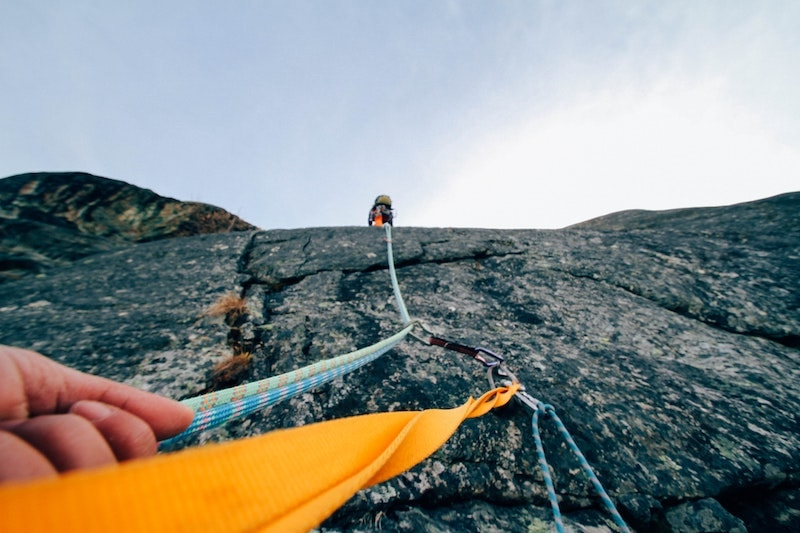 climbing ropes on face of boulder
