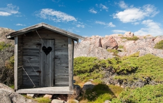 alpine outhouse with heart shaped window