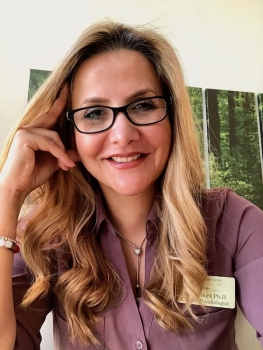 Dr. Allie Selkirk wearing glasses and mauve blouse headshot