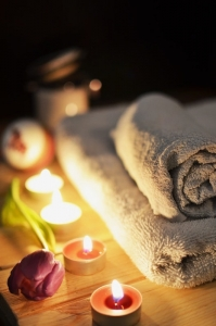 candles and spa towels with a rose