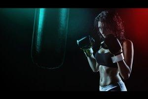 Dark image of female boxer